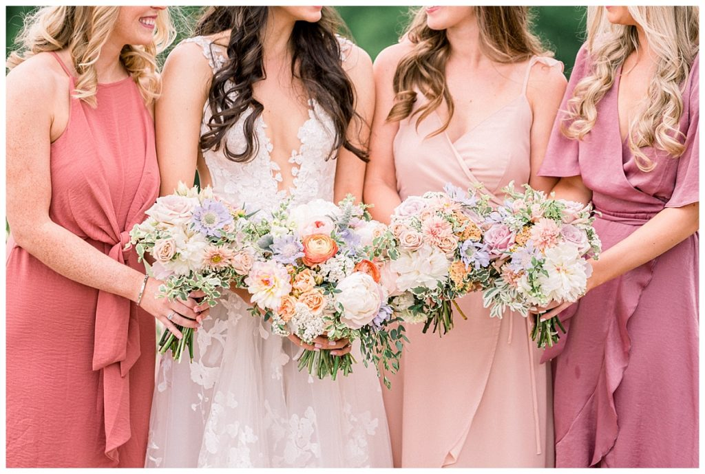 bride with bridesmaids holding bouquet