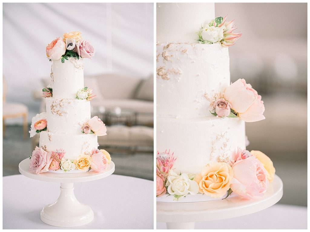 luxury highend white wedding cake with orange and light pink flowers