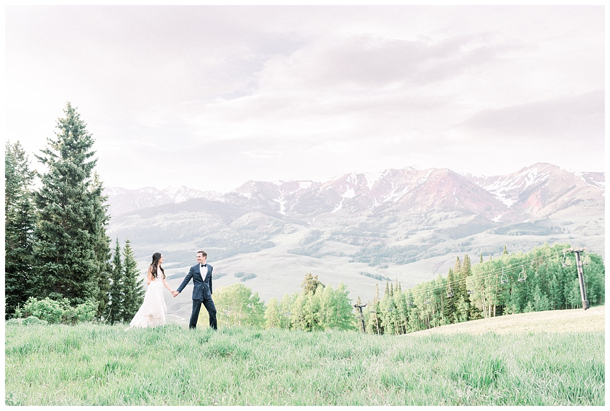 bride and groom on mountainside in crested butte colorado